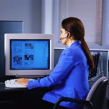 Woman with headphones working on computer
